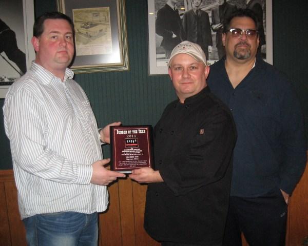 "Board Member Greg Bartholomew, Presents the 2011 Burger of the Year award to Chef Denny ""Stu"" Baumiller and co-owner Dino Haidaris."